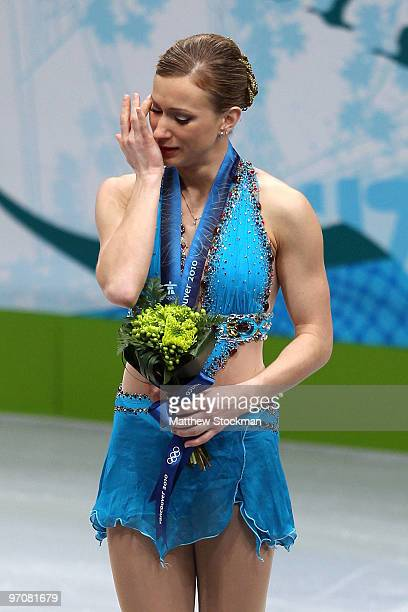 Joannie Rochette of Canada reacts after winning bronze in the Ladies Free Skating during the flower ceremony on day 14 of the 2010 Vancouver Winter...