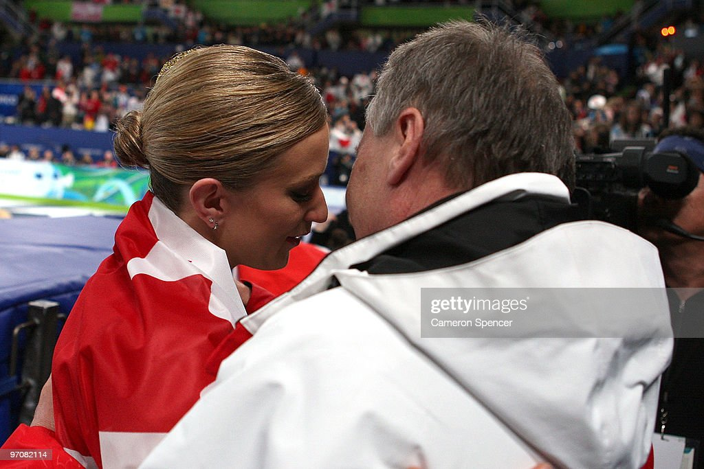 Joannie Rochette of Canada reacts with her father Normand in the Ladies Free Skating on day 14 of the 2010 Vancouver Winter Olympics at Pacific Coliseum on February 25, 2010 in Vancouver, Canada.