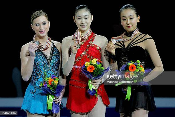 Joannie Rochette YuNa Kim of Korea and Mao Asada of Japan pose for photographers on the winners podium after the Ladies Free Skate during the ISU...