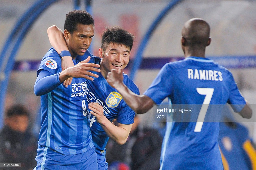 Joao Alves of Jiangsu Suning celebrates with Ramires after scoring his team's first goal with a penalty during the AFC Champions League Group E match...