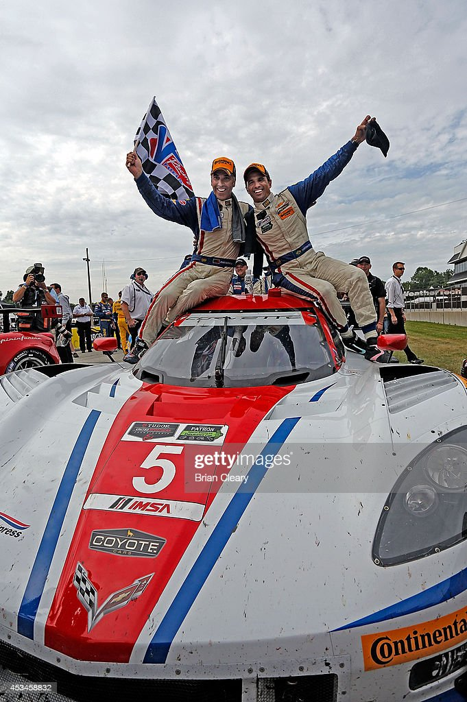 Joao Barbosa (L) and <a gi-track='captionPersonalityLinkClicked' href=/galleries/search?phrase=Christian+Fittipaldi&family=editorial&specificpeople=224784 ng-click='$event.stopPropagation()'>Christian Fittipaldi</a> celebrate after winning the IMSA Tudor Series race at Road America on August 10, 2014 in Elkhart Lake, Wisconsin.