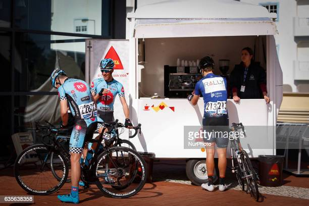 Joao Bento of RPBoavista and Adam de Vos of Rally Cycling drink coffee before the 2nd stage of the cycling Tour of Algarve between Lagoa and Alto do...