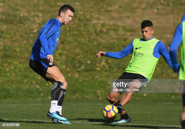 Joao Cancelo and Ivan Perisic of FC Internazionale compete for the ball during the FC Internazionale training session at Suning Training Center at...