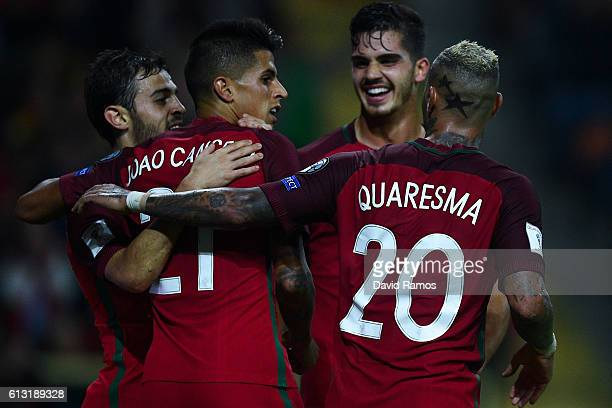 Joao Cancelo of Portugal celebrates after scoring his team's third goal during the FIFA 2018 World Cup Qualifier between Portugal and Andorra at...