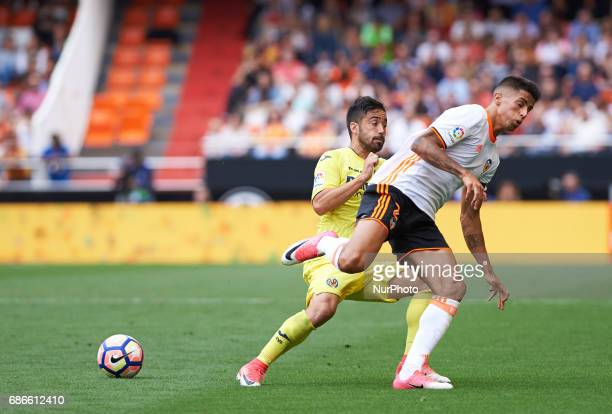 Joao Cancelo of Valencia CF and Jaume Costa of Villarreal CF during their La Liga match between Valencia CF and Villarreal CF at the Mestalla Stadium...