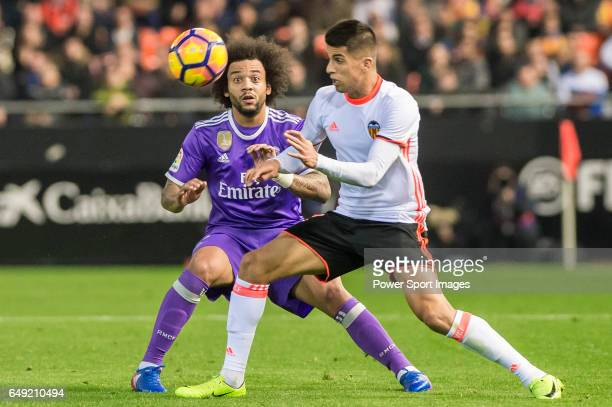 Joao Cancelo of Valencia CF battles for the ball with Marcelo Vieira Da Silva of Real Madrid during their La Liga match between Valencia CF and Real...