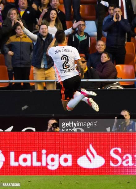 Joao Cancelo of Valencia CF celebrates after scoring a goal during their La Liga match between Valencia CF and Deportivo de la Corua at the Mestalla...
