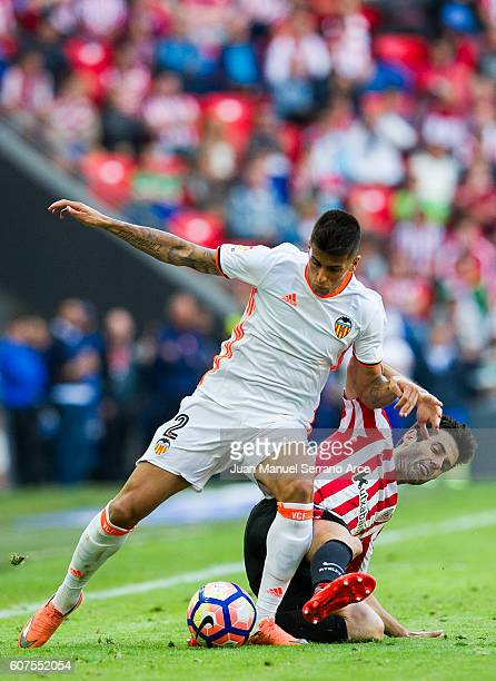 Joao Cancelo of Valencia CF competes for the ball with Markel Susaeta of Athletic Club during the La Liga match between Athletic Club Bilbao and...