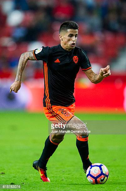 Joao Cancelo of Valencia CF controls the ball during the La Liga match between Real Sporting de Gijon and Valencia CF at Estadio El Molinon on...