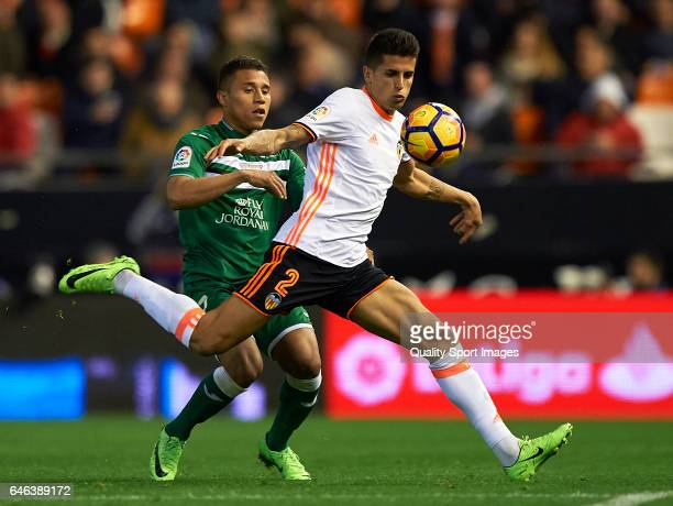 Joao Cancelo of Valencia competes for the ball with Darwin Daniel Machis of Leganes during the La Liga match between Valencia CF and CD Leganes at...
