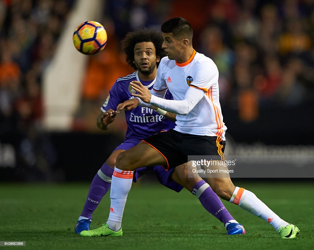 Joao Cancelo (R) of Valencia competes for the ball with Marcelo of Real Madrid during the La Liga match between Valencia CF and Real Madrid at Mestalla Stadium on February 22, 2017 in Valencia, Spain.