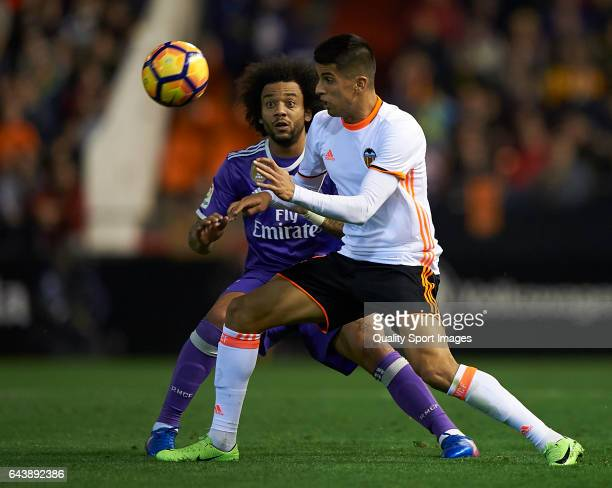 Joao Cancelo of Valencia competes for the ball with Marcelo of Real Madrid during the La Liga match between Valencia CF and Real Madrid at Mestalla...