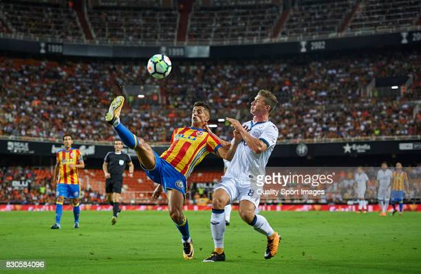 Joao Cancelo of Valencia competes for the ball with Robin Gosens of Atalanta during the preseason friendly match between Valencia CF and Atalanta BC...