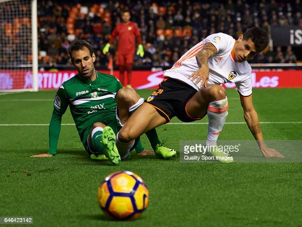Joao Cancelo of Valencia competes for the ball with Victor Diaz of Leganes during the La Liga match between Valencia CF and CD Leganes at Mestalla...