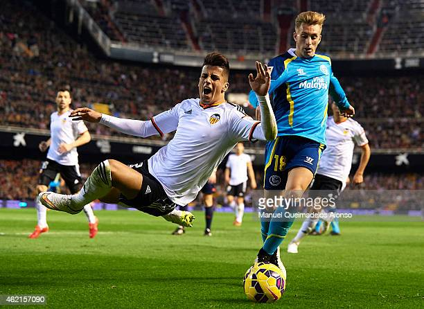 Joao Cancelo of Valencia is tackled by Gerard Deulofeu of Sevilla during the La Liga match between Valencia CF and Sevilla FC at Estadi de Mestalla...