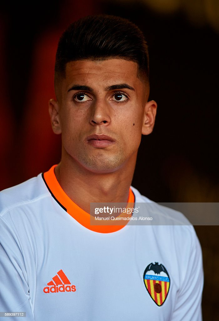 Joao Cancelo of Valencia looks on during the team official presentation ahead of the pre-season friendly match between Valencia CF and AC Fiorentina at Estadio Mestalla on August 13, 2016 in Valencia, Spain.