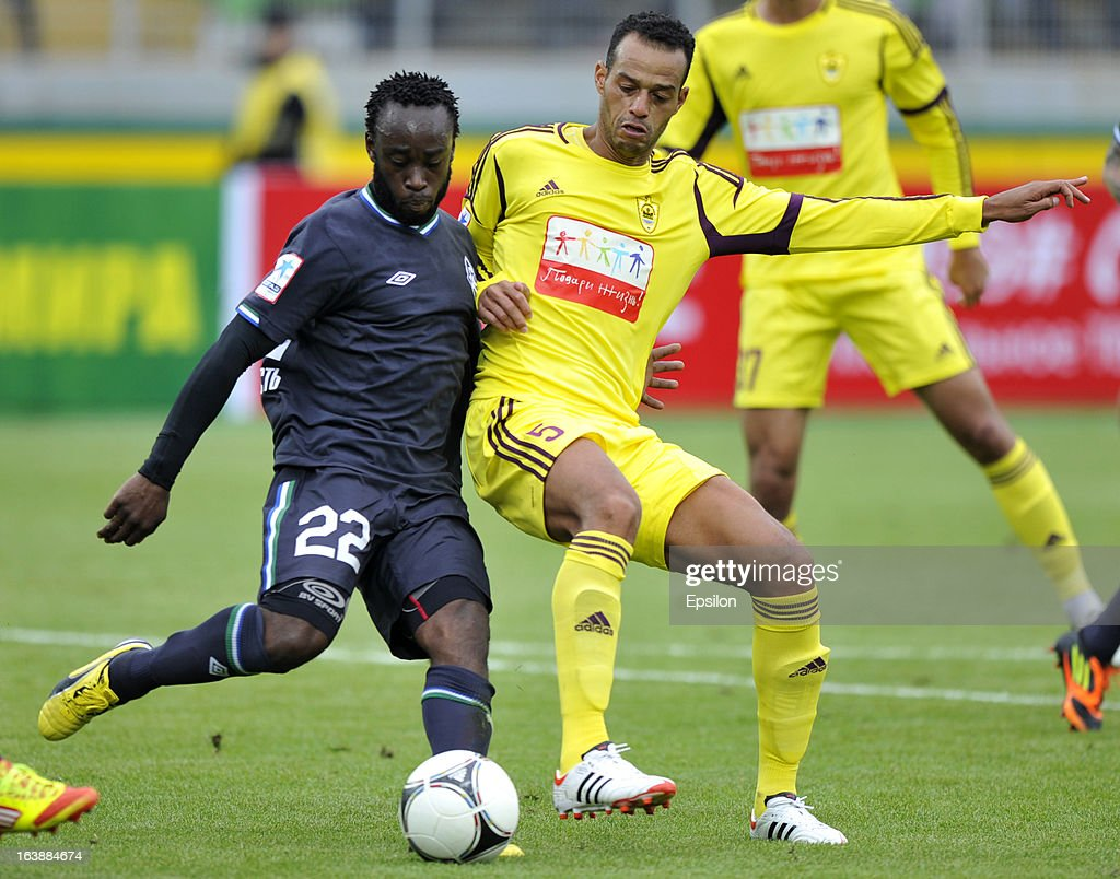 Joao Carlos of FC Anzhi Makhachkala is challenged by Reginal Goreux of FC Krylia Sovetov Samara during the Russian Premier League match between FC Anzhi Makhachkala and FC Krylia Sovetov Samara at the Anzhi Arena Stadium on March 17, 2013 in Kaspiysk, Russia.