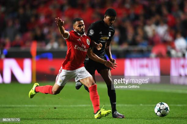 Joao Carvalho of Benfica and Marcus Rashford of Manchester United battle for posession during the UEFA Champions League group A match between SL...