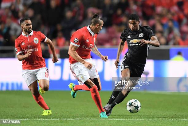 Joao Carvalho of Benfica Ljubomir Fejsa of Benfica and Marcus Rashford of Manchester United battle for posession during the UEFA Champions League...
