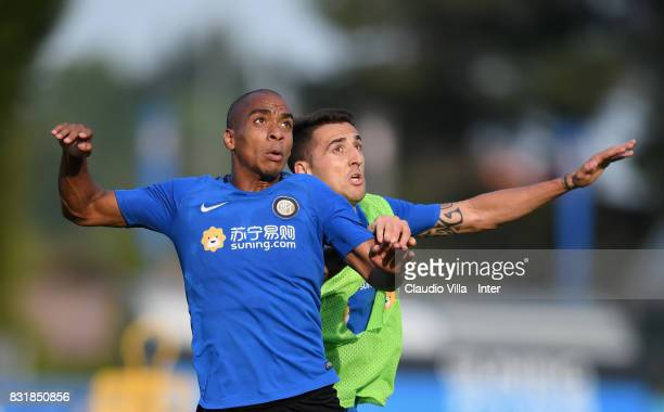 Joao Mario and Matias Vecino of FC Internazionale compete for the ball during a training session at Suning Training Center at Appiano Gentile on...