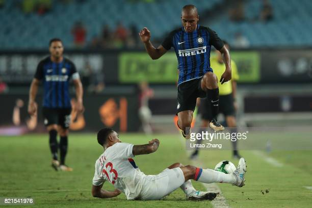 Joao Mario Eduardo of FC Internationale competes for the ball with Kenny Tete of Olympique Lyonnais during the 2017 International Champions Cup China...