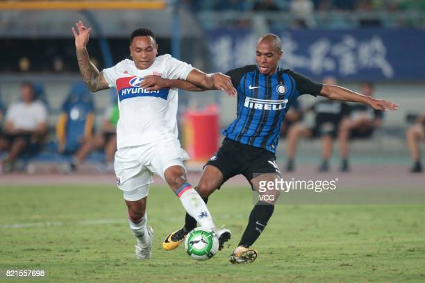 Joao Mario of FC Internazionale and Kenny Tete of Lyon compete for the ball during the 2017 International Champions Cup match between FC...
