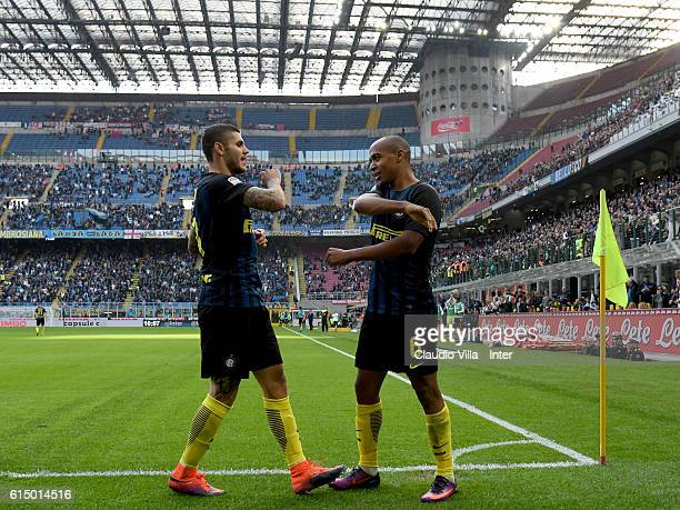Joao Mario of FC Internazionale celebrates after scoring the opening goal with Mauro Icardi during the Serie A match between FC Internazionale and...