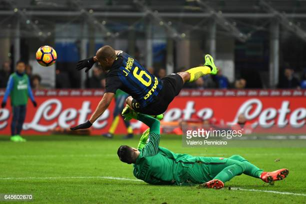 Joao Mario of FC Internazionale clashes with Wojciech Szczesny of AS Roma during the Serie A match between FC Internazionale and AS Roma at Stadio...