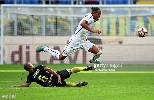 Joao Mario of FC Internazionale competes for the ball with Brun Alves of Cagliari Calcio during the Serie A match between FC Internazionale and...