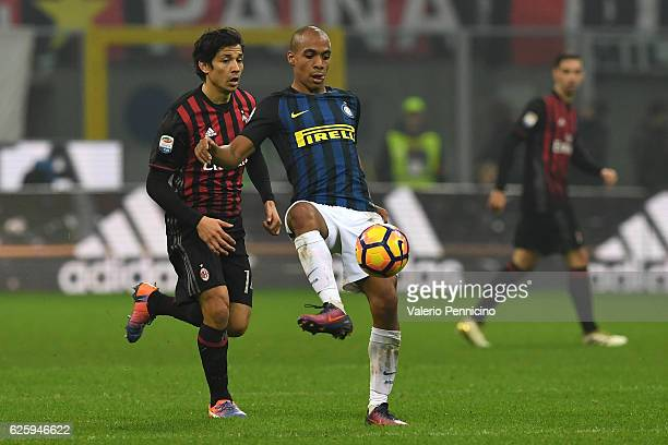 Joao Mario of FC Internazionale in action against Mati Fernandez of AC Milan during the Serie A match between AC Milan and FC Internazionale at...