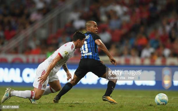 Joao Mario of FC Internazionale of FC Internazionale and James Rodriguez of Bayern compete for the ball during the International Champions Cup match...