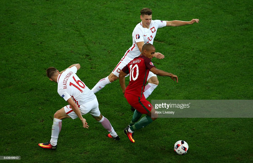 Joao Mario (C) of Portugal competes for the ball against <a gi-track='captionPersonalityLinkClicked' href=/galleries/search?phrase=Jakub+Blaszczykowski&family=editorial&specificpeople=2290714 ng-click='$event.stopPropagation()'>Jakub Blaszczykowski</a> (L) and <a gi-track='captionPersonalityLinkClicked' href=/galleries/search?phrase=Lukasz+Piszczek&family=editorial&specificpeople=4380352 ng-click='$event.stopPropagation()'>Lukasz Piszczek</a> (R) of Poland during the UEFA EURO 2016 quarter final match between Poland and Portugal at Stade Velodrome on June 30, 2016 in Marseille, France.
