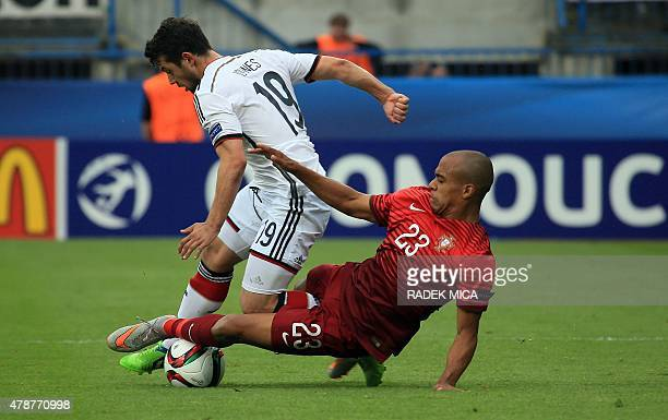 Joao Mario of Portugal fights for the ball with Amin Younes of Germany during the UEFA Under 21 European Championship 2015 semi final football match...