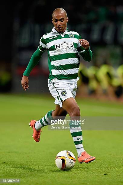 Joao Mario of Sporting Lisbon controls the ball during the UEFA Europa League round of 32 second leg match between Bayer Leverkusen and Sporting...