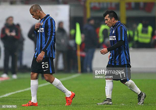 Joao Miranda and Gary Alexis Medel of FC Internazionale Milano leave the field disappointed at the end of the Serie A match between AC Milan and FC...