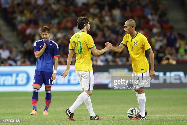 Joao Miranda and Kaka of Brazil celebrate after defeating Japan during the international friendly match between Japan and Brazil at the National...