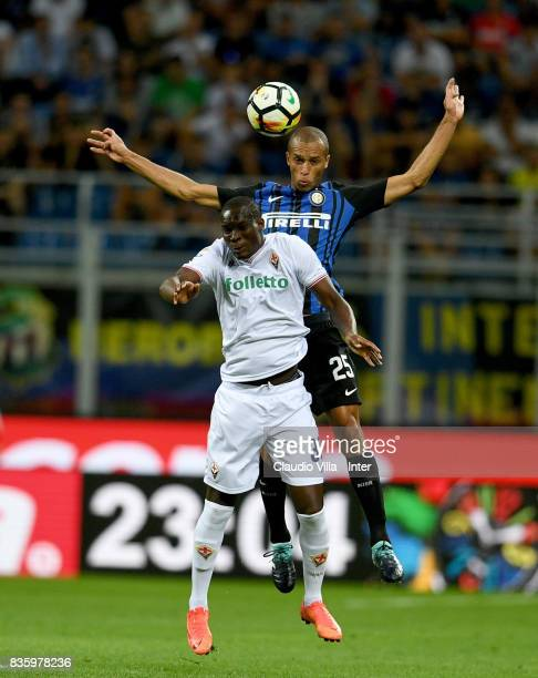 Joao Miranda de Souza Filho of FC Internazionale and Khouma Elhadji Babacar of ACF Fiorentina compete for the ball during the Serie A match between...