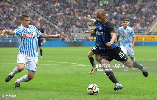 Joao Miranda de Souza Filho of FC Internazionale Milano is challenged by Federico Viviani of Spal during the Serie A match between FC Internazionale...