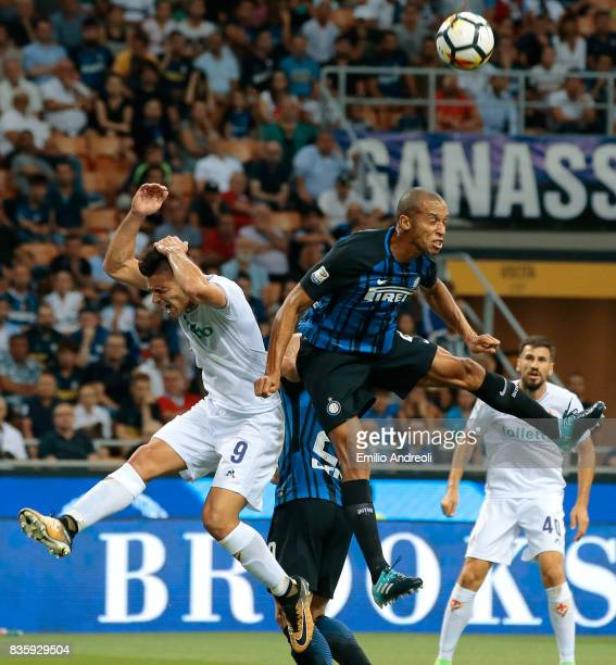 Joao Miranda de Souza Filho of FC Internazionale Milano jumps for the ball with Giovanni Simeone of ACF Fiorentina during the Serie A match between...