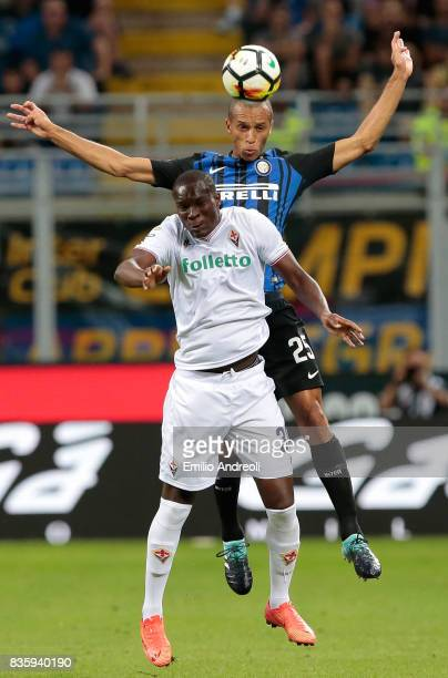 Joao Miranda de Souza Filho of FC Internazionale Milano jumps for the ball with Khouma Babacar of ACF Fiorentina during the Serie A match between FC...