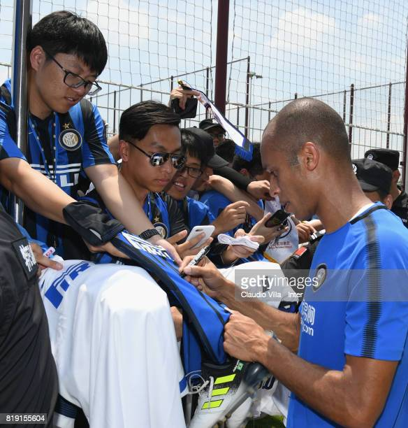 Joao Miranda de Souza Filho of FC Internazionale signs autographs for fans after a FC Interazionale training session at Suning training center on...