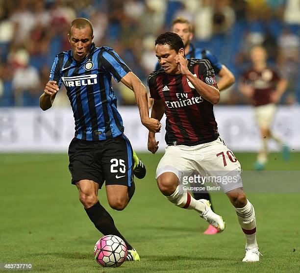 Joao Miranda De Souza of Inter and Carlos Bacca Ahumada of Milan in action during the TIM preseason tournament match between AC Milan and FC...