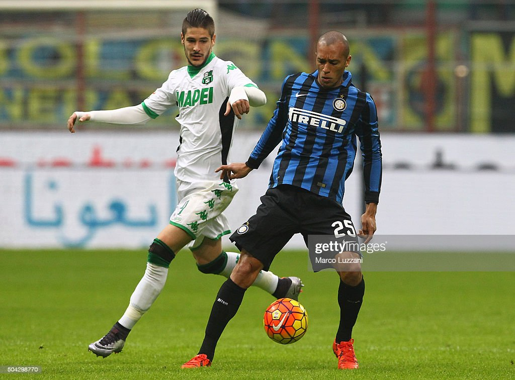 Joao Miranda is challenged by Diego Falcinelli of US Sassuolo Calcio during the Serie A match between FC Internazionale Milano and US Sassuolo Calcio...