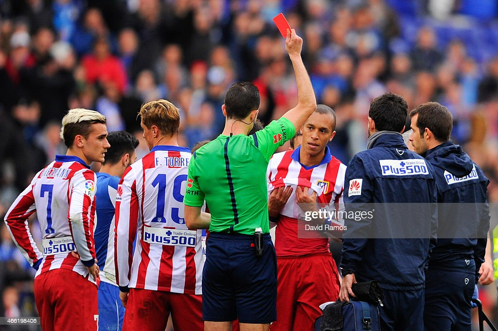 Joao Miranda of Atletico de Madrid is shown a red card for a challenge on Abraham Gonzalez of RCD Espanyol during the La Liga match between RCD...