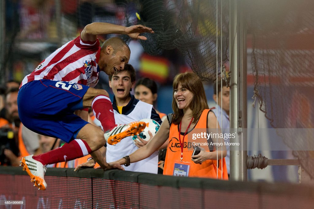 Joao Miranda of Atletico de Madrid jumps the advertising boarding celebrating scoring the opening goal during the La Liga match between Club Atletico de Madrid and Elche FC at Vicente Calderon Stadium on April 18, 2014 in Madrid, Spain.