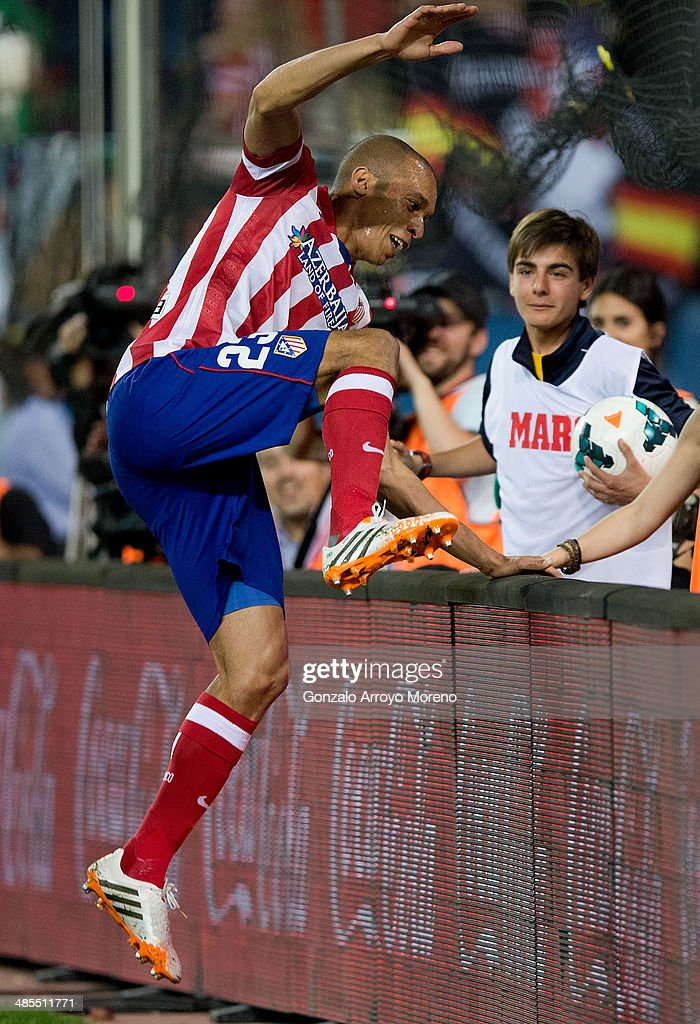Joao Miranda of Atletico de Madrid jumps the advertising boarding celebrating their opening goal during the La Liga match between Club Atletico de Madrid and Elche FC at Vicente Calderon Stadium on April 18, 2014 in Madrid, Spain.
