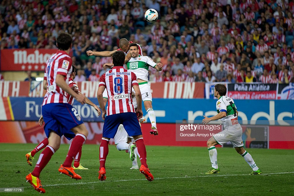 Joao Miranda of Atletico de Madrid scores their opening goal from a header during the La Liga match between Club Atletico de Madrid and Elche FC at Vicente Calderon Stadium on April 18, 2014 in Madrid, Spain.