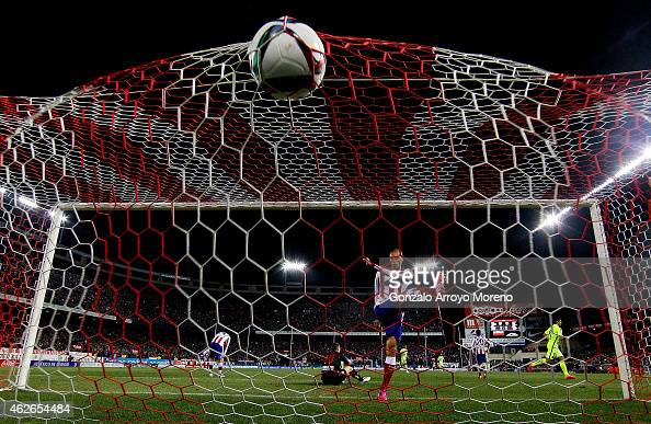 Joao Miranda of Atletico de Madrid strikes the ball annoyed as FC Barcelona players celebrate their third goal during the Copa del Rey Round of 8...