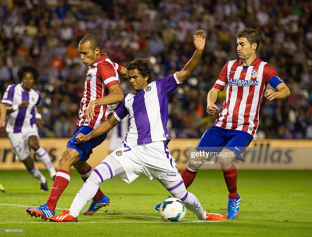 Joao Miranda (R) of Club Atletico de Madrid blocks Humberto Osorio (C) of Real Valladolid CF while Gabi looks on during the La Liga match between Real Valladolid CF and Club Atletico de Madrid at Estadio Jose Zorilla on September 21, 2013 in Valladolid, Spain.