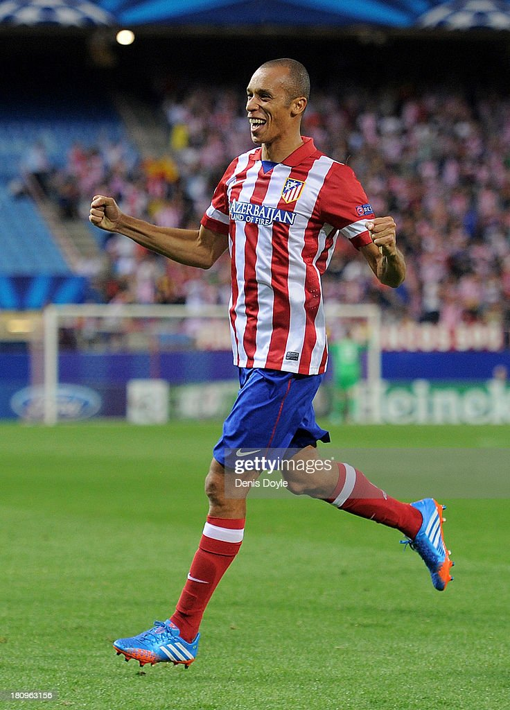 Joao Miranda of Club Atletico de Madrid celebrates after scoring his team's opening goal during the UEFA Champions League Group G match between Club...